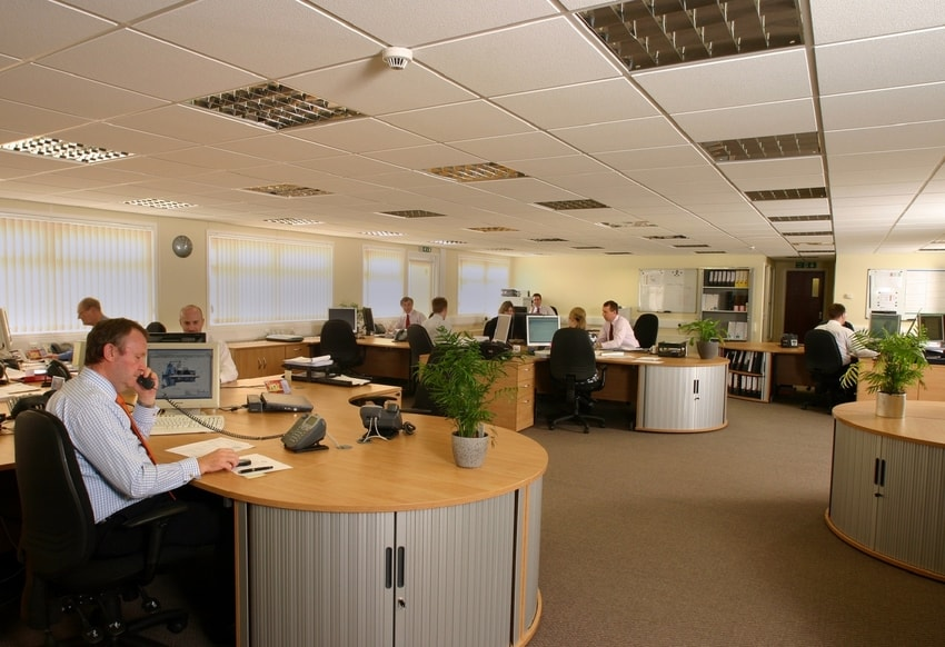 Professional office with busy workers and professionally cleaned carpeting