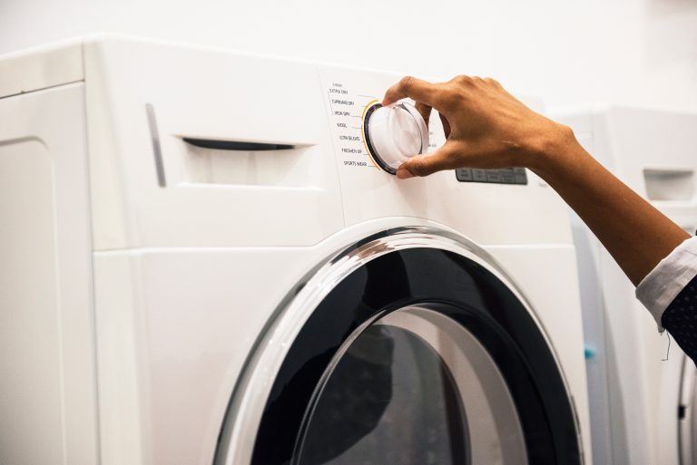 Woman Using Dryer