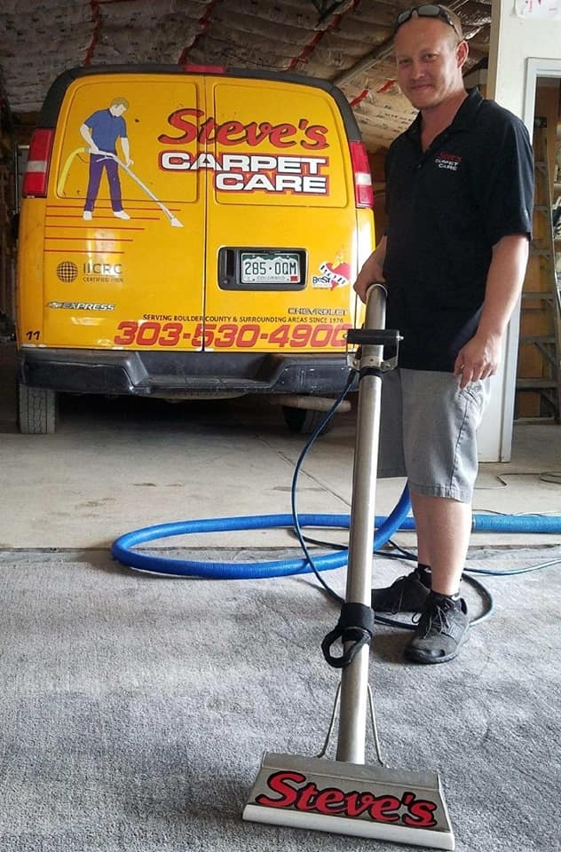 Steve's Carpet Care Employee With Truck-Mounted Steam Cleaner