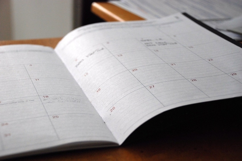 Day Planner Open on Kitchen Table to Schedule Professional Carpet Cleaning Appointment