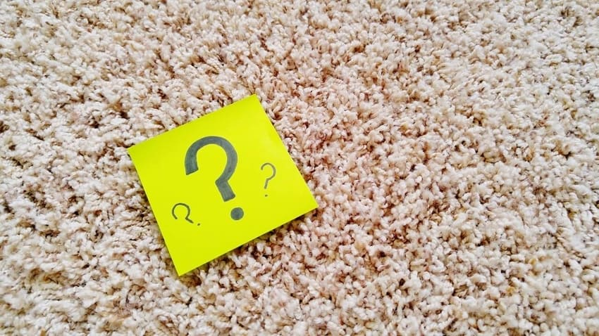 Post-It With Question Mark On Carpeting